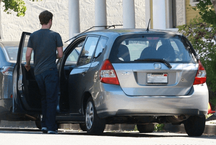 mark zuckerberg getting into his honda fit