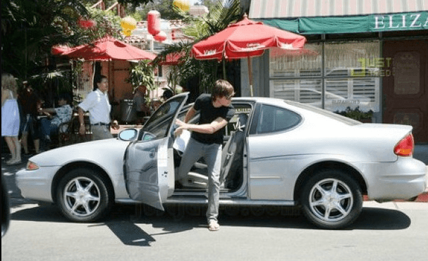zac efron stepping out of his oldsmobile alero