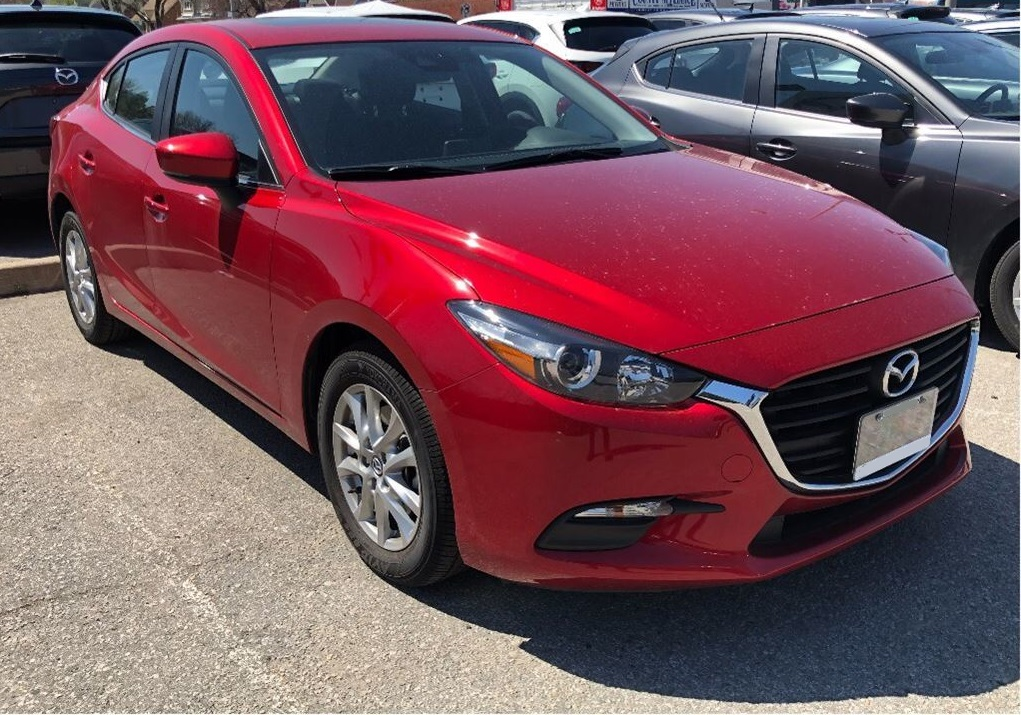 2018 Red Mazda3 Parked in a lot small affordable cheap car
